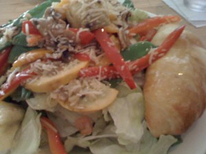 hot vegetable salad with croissant